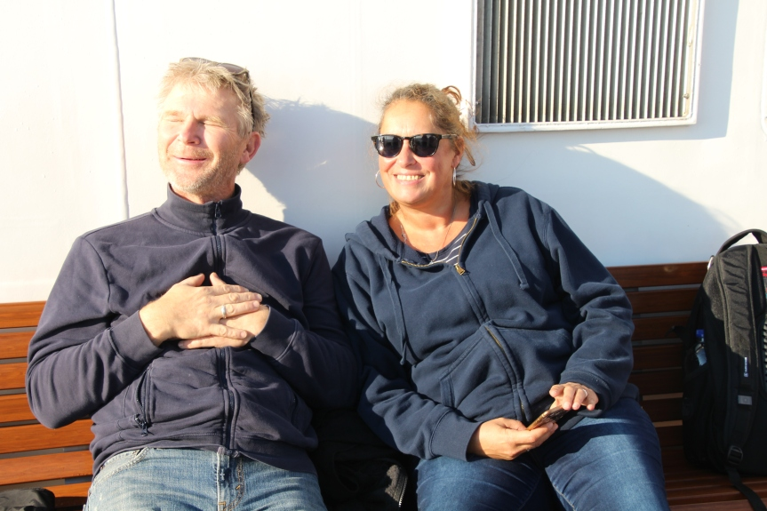 Burkhard and Carina enjoying the sunny side of the ship on the way to Helgoland via Cuxhaven