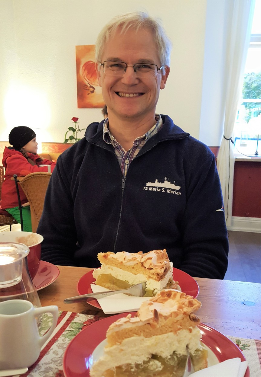 The birthday boy, Andreas Muenchow, with his favorite gooseberry torte and hot chocolate. Schleswig. Photo by Dragonfly Leathrum
