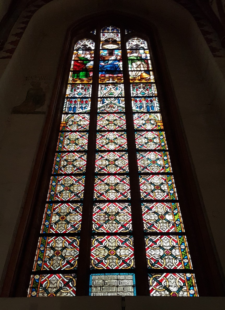 Beautiful, intricate, huge stained glass window in the Cathedral of St. Peter of Schleswig. Photo by Dragonfly Leathrum