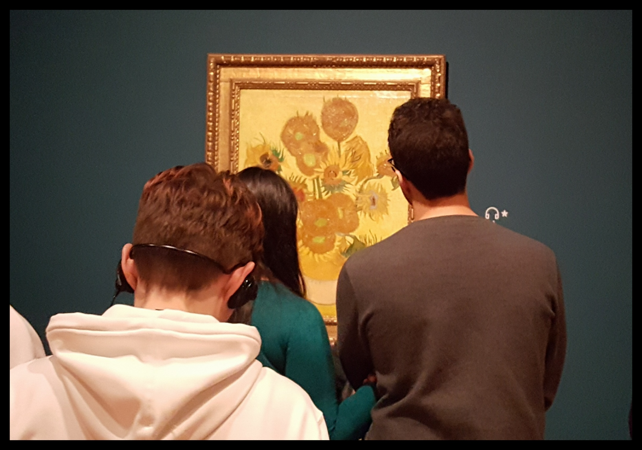 Peeking over the crowds at the Van Gogh Museum.