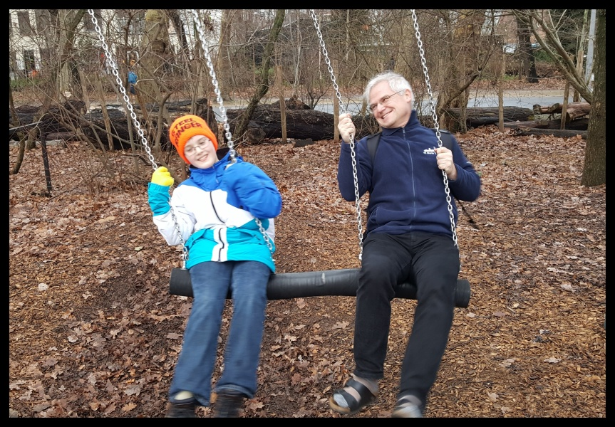 Swinging in the rain... Uncle Andreas, Auntie Fly and shorter nephew take a much needed museum break in Vondel Park Amsterdam. Photo by Dragonfly Leathrum