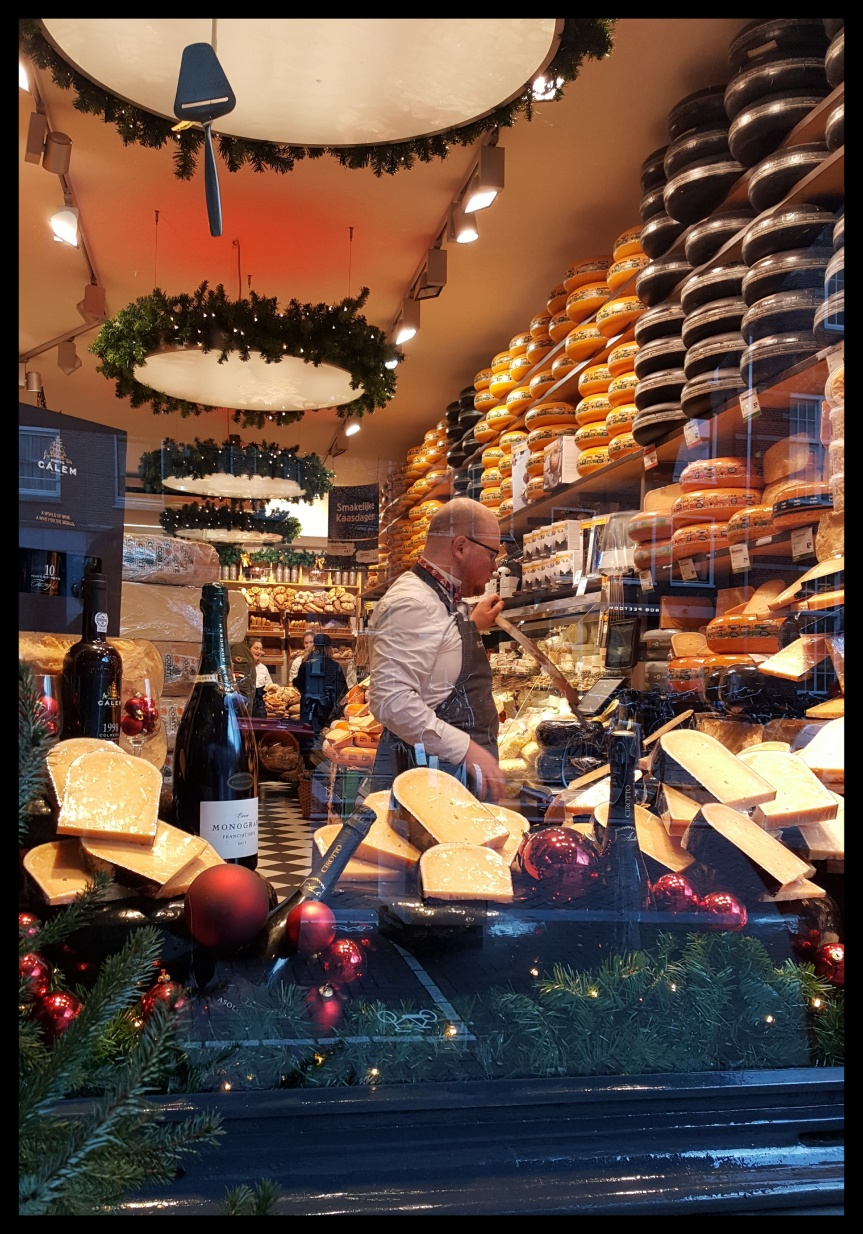 We walked past this awesome cheese shop. Photo by Dragonfly Leathrum