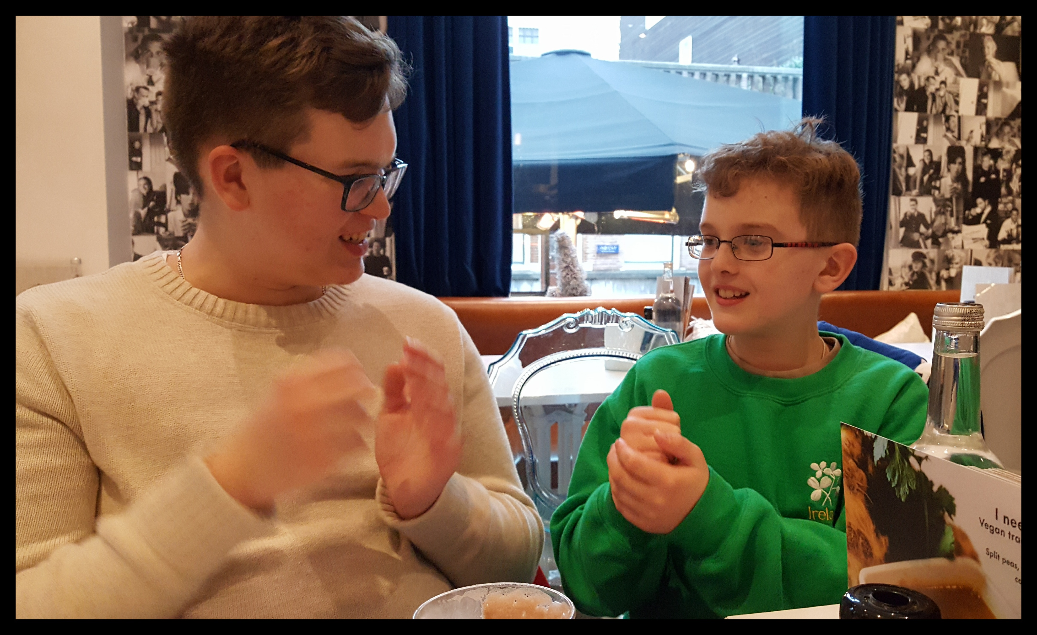 Nephews entertaining themselves in a cafe' with a rousing game of Rock, Paper, Scissors, Batman, Bunny Foo Foo. It's their own creation. Bunny Foo Foo trumps. Photo by Dragonfly Leathrum