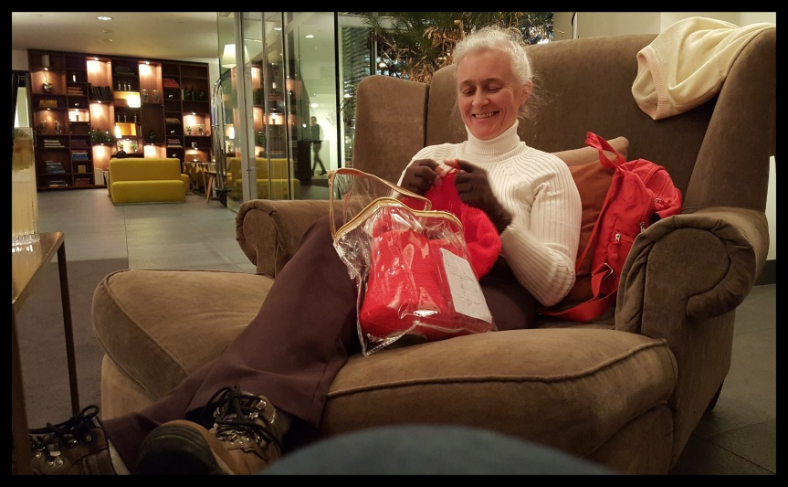 My brother's wife can knit anywhere. Here she is in a giant chair in their hotel lobby. Photo by Dragonfly Leathrum