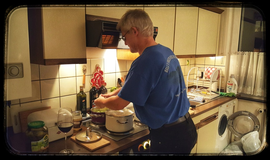 Uncle Andreas cooking soup all afternoon. Luckily he has some wine. Notice the laundry pile in the corner by our baby washer.