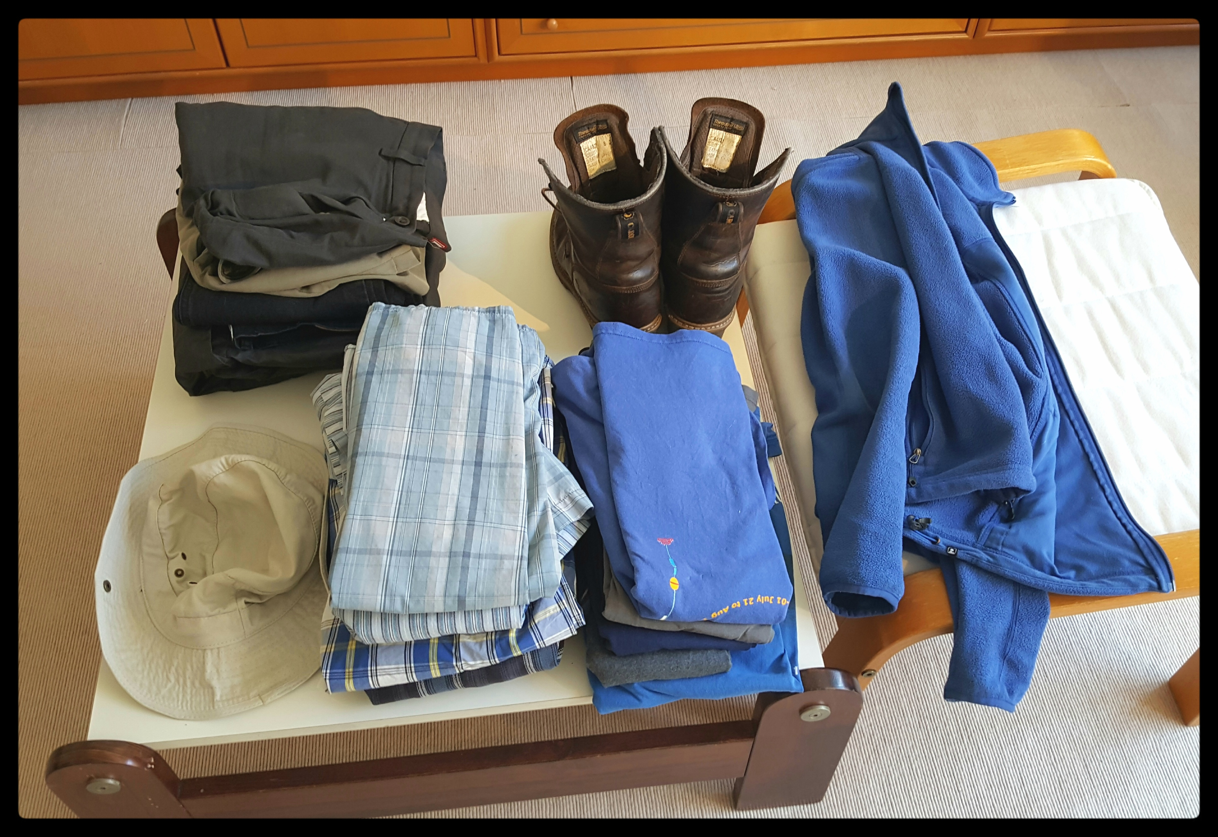 The clothes that Andreas has needed and worn this year minus 1 pair of pants, 1 t-shirt, a fleece jacket and a windbreaker. (Things that he wore to work today) Photo by Dragonfly Leathrum