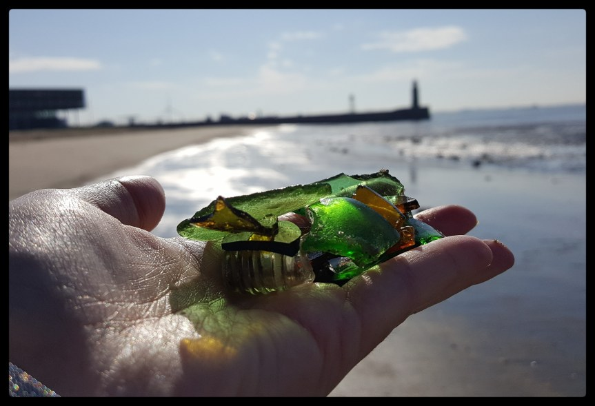 A good day at the beach. People ask me if I'm collecting rocks and I reply no, I'm collecting garbage to make art. Then they look at me funny and I say I'm picking up glass so the doggies don't hurt their feet. This makes them happy. Photo by Dragonfly Leathrum
