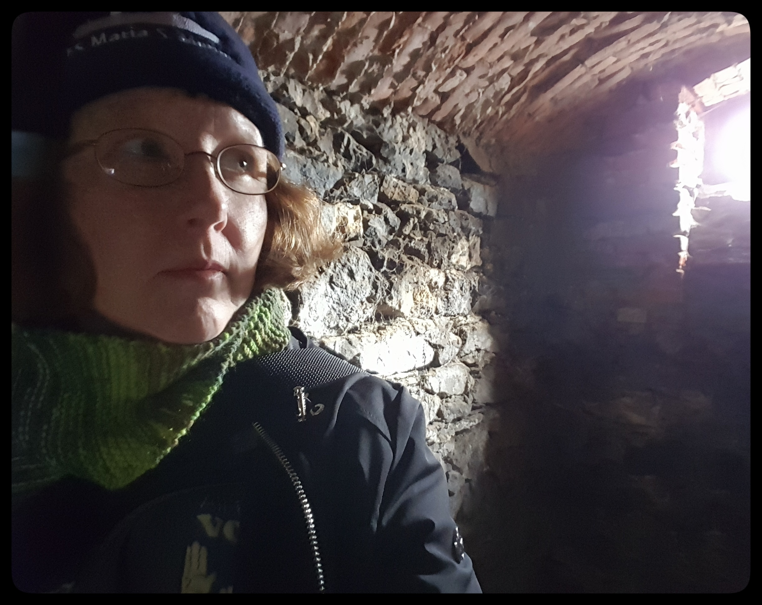 Selfie in a spooky cellar that would make an awesome speakeasy. Photo by Dragonfly Leathrum