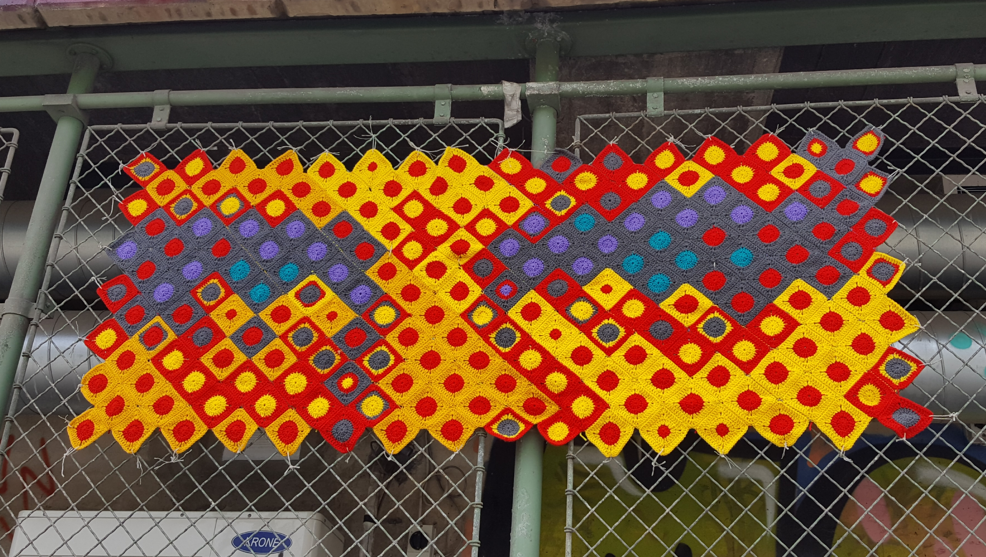 If you look at this Yarn Bomb photo from a distance you will see a face. Danube Canal. Photo by Dragonfly Leathum