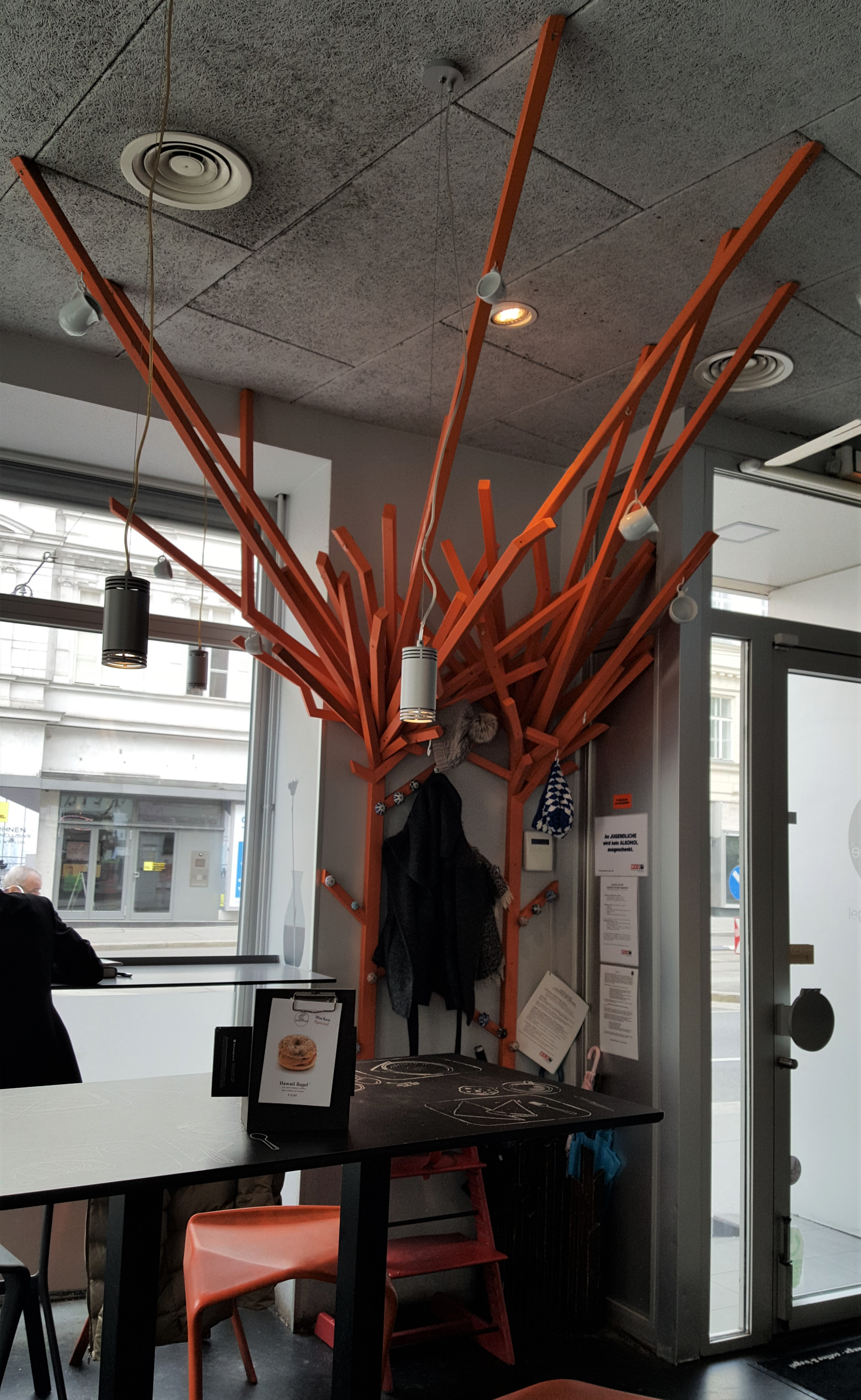 Coats, coffee cups, bags? There's a tree for that at Blue Orange.