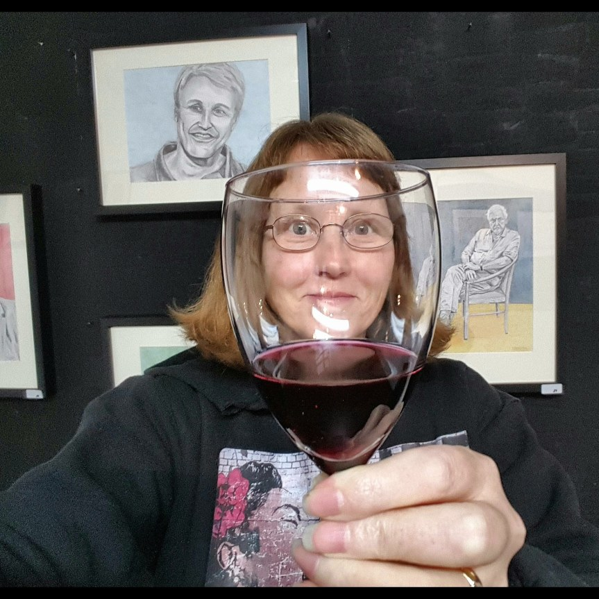 Newark, Delaware artist Dragonfly Leathrum exhibits in Dragonfly Germany. WHAT?!? Ha ha, seen here enjoying her show through wine goggles. Selfie by Dragonfly Leathrum