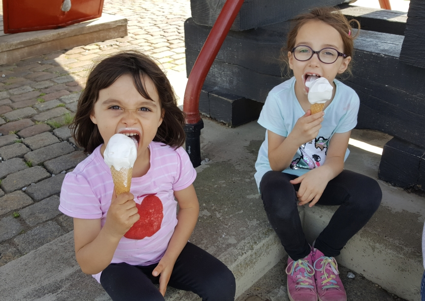 Sitting under a docked ship for shade eating ice cream. Photo by Dragonfly Leathrum