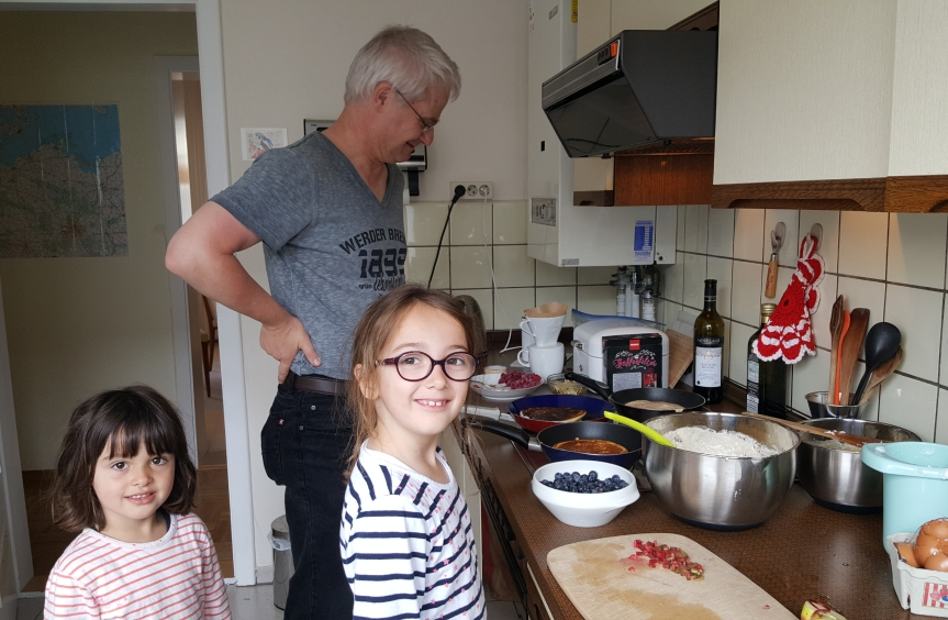 Sunday morning pancakes with Andreas. The girls helped with the cooking and got a few math lessons with blueberries. We also know Andreas' secret ingredient now thanks to the eight year olds sensitive nose. Photo by Dragonfly Leathrum