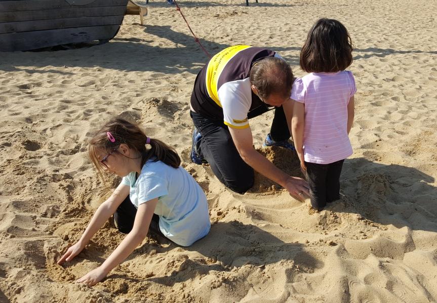 Mike burying the kids.