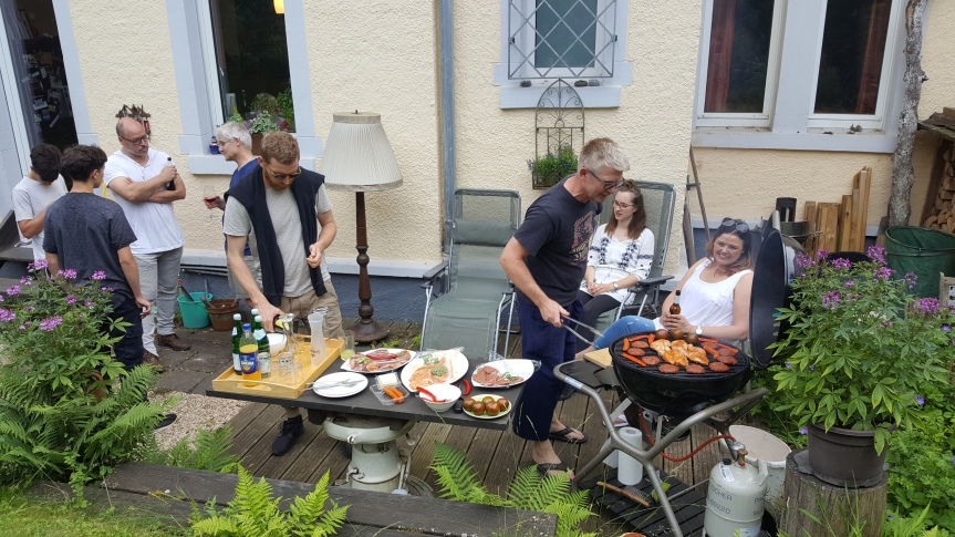 Burkhard cooking dinner. Photo by Dragonfly Leathrum