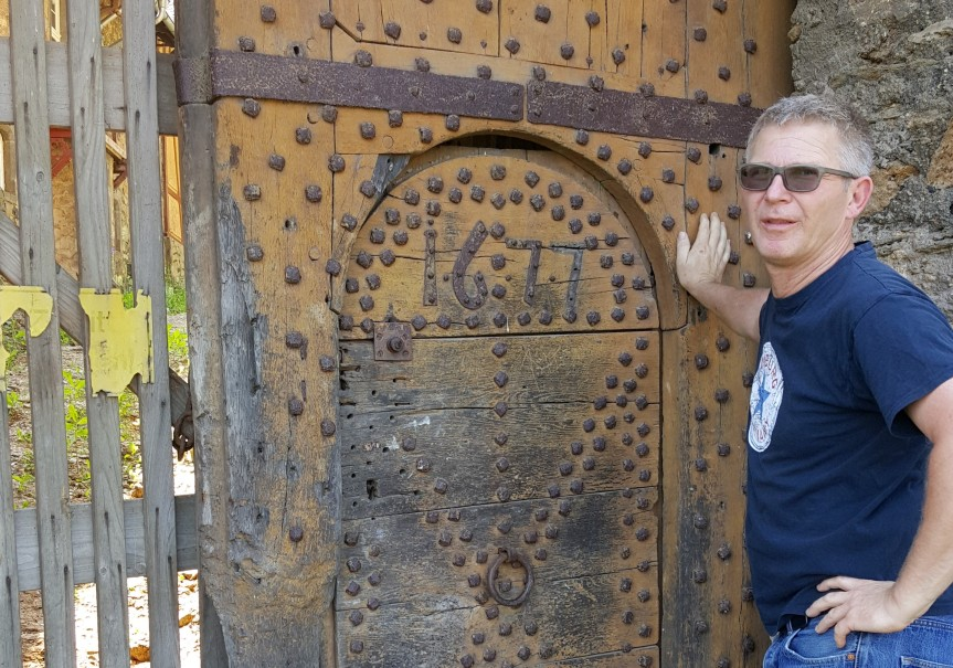 The origins of the castle date back to 915 and it was first mentioned around 1197. Burkard and I found a more modern door walking around the outside.