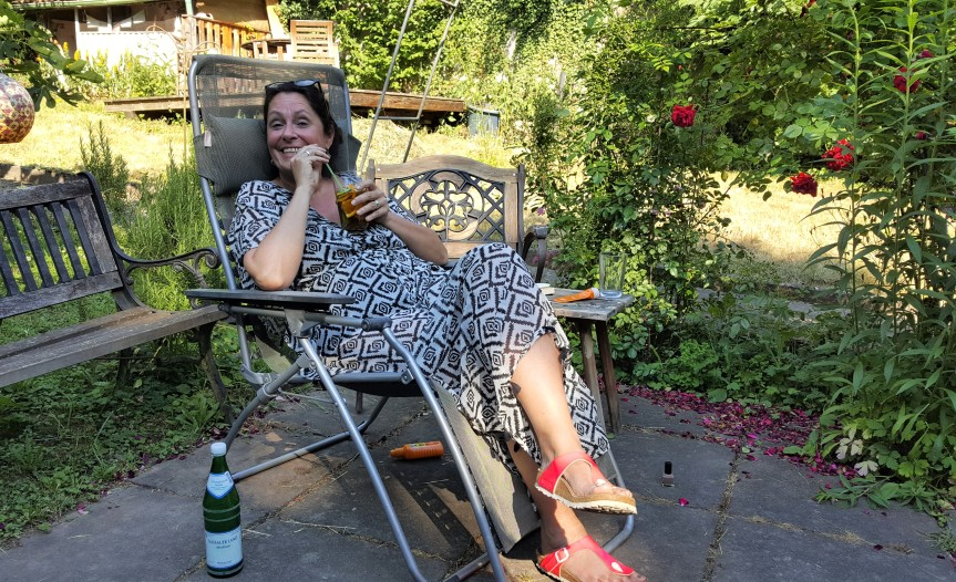 Carina in the garden with the Queen's drink. Photo by Dragonfly Leathrum