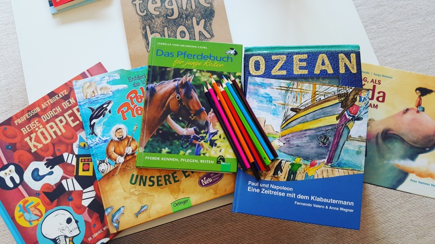 Library books, a book about the animals in the zoo by gallery owner Fernando Valero and paper and pencils were my way of keeping kids busy.
