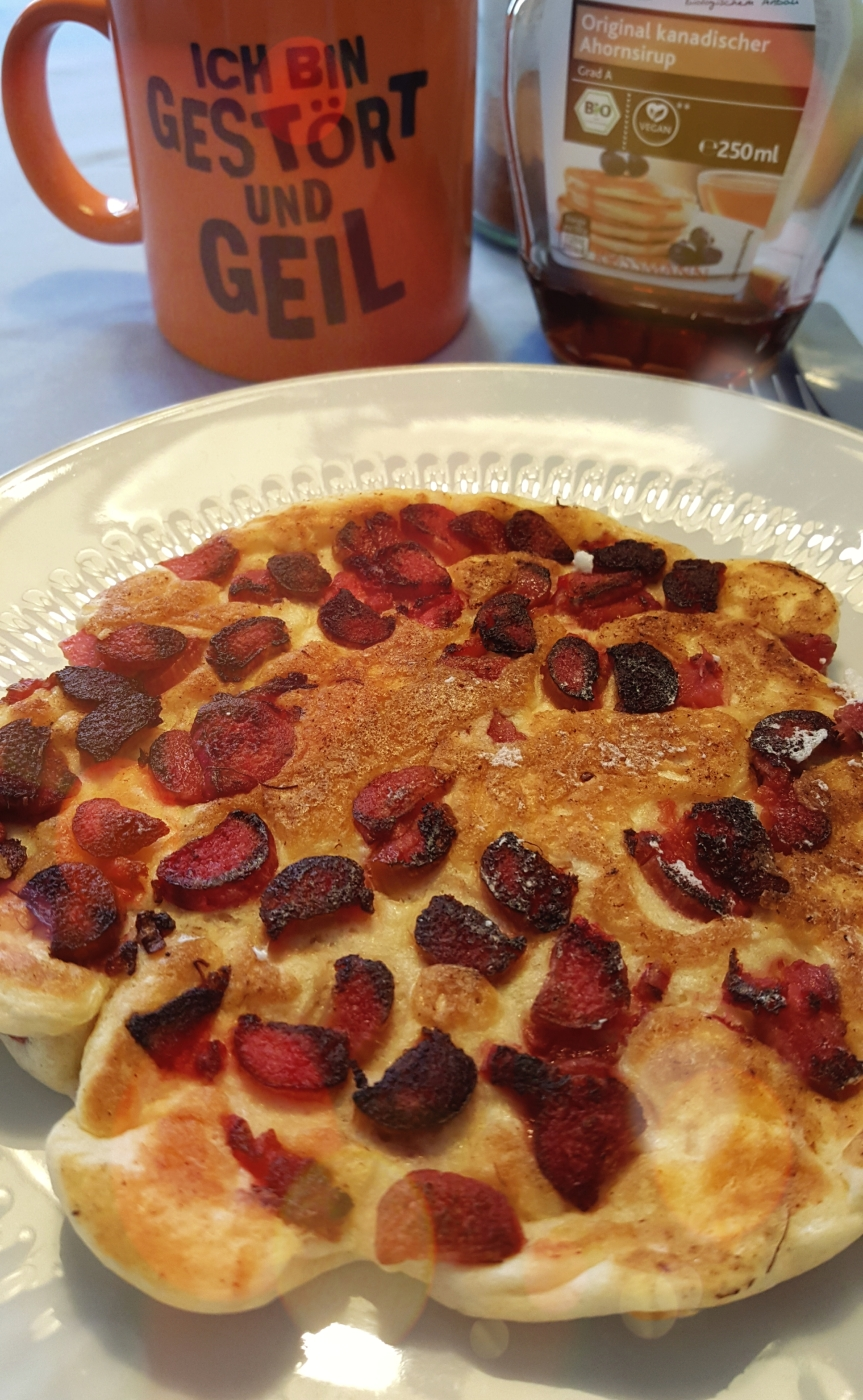 Andreas cooks pancakes every Sunday. This is his first rhubarb pancake. Yum! Photo by Dragonfly Leathrum