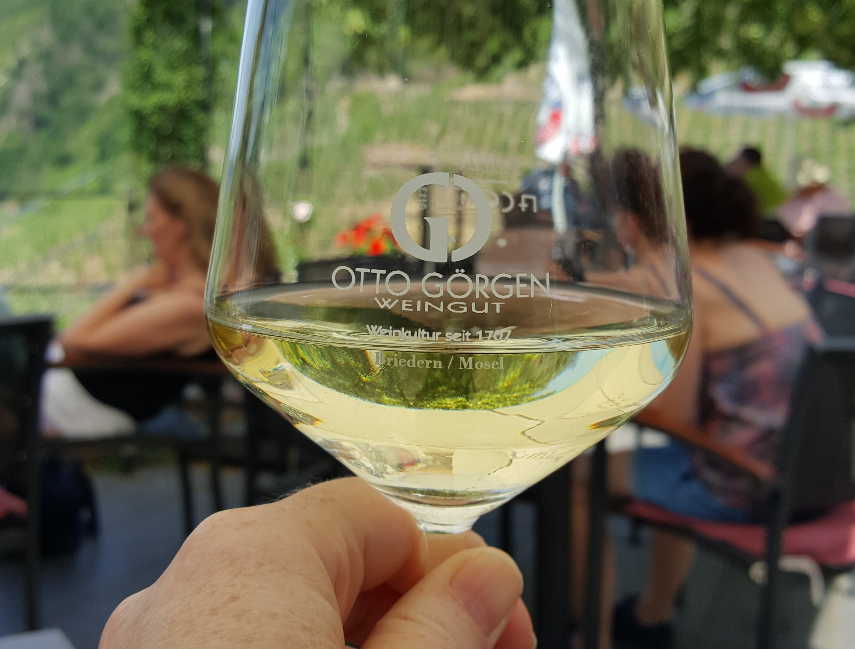 It doesn't get more local that looking at the vineyard through the wine glass. Lunch in front of St. Joseph's Church in Beilstein on the Moselle River. Photo by Dragonfly Leathrum