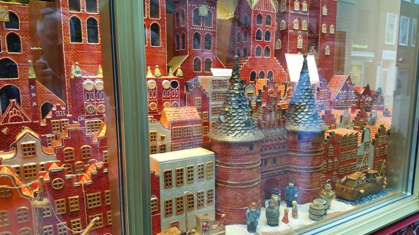 The town of Lubeck created in marzipan in the window of Niederegger. Photo by Dragonfly Leathrum