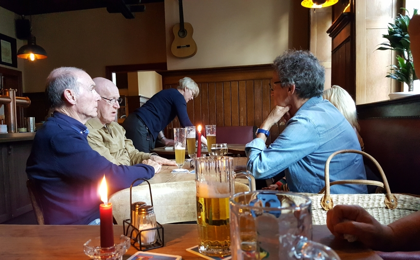 Dinner at the Alte Zolln where Andreas' grandfather used to drink. The woman with the blue shirt and watch is local and was sitting alone. The other three are visiting Lubeck from Scotland and were seated at her table because seats were available. She immediately asked about their thoughts on Brexit. They replied that they absolutely didn't want to talk about politics. within ten minutes they were talking about politics. Photo by Dragonfly Leathrum