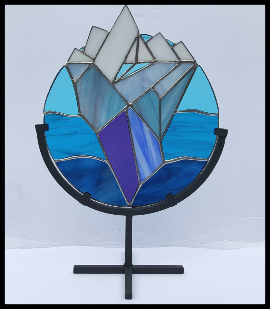 Iceberg stained glass created for the Newark Arts Alliance fundraising event. Photo and artwork by Dragonfly Leathrum