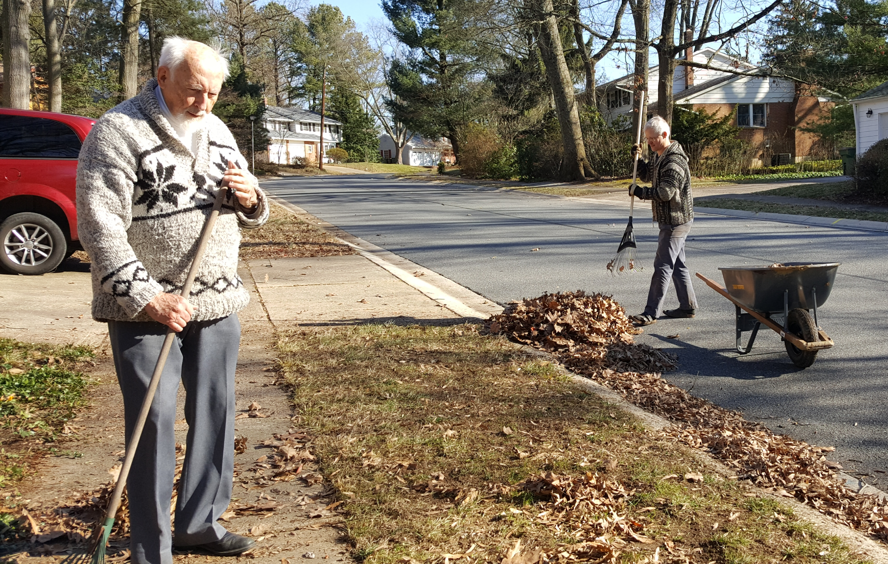 Andreas helps neighbor Francis with his early spring clean up. Photo by Dragonfly Leathrum