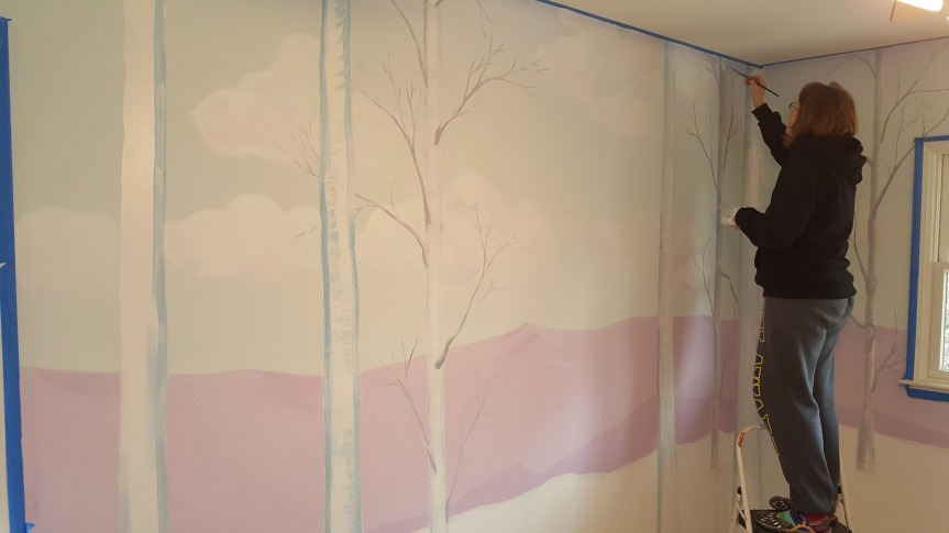 Painting branches on Aspen trees in the bedroom. Photo by Andreas Muenchow