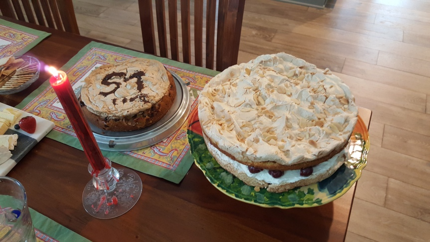 My birthday cakes. on the left a rhubarb cake by Andreas. That's a German one. I'm not 57. On the right a cake by Christina. Both very delicious and German. Christina's cake was her mother's recipe.